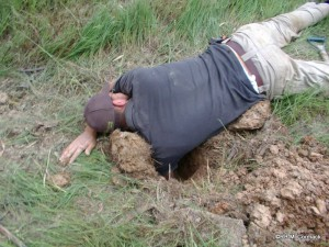 Lying on the ground, stretching down with your shoulder in the hole can yield some great results
