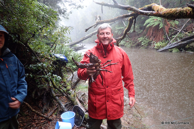 Despite the rain Craig Burnes is happy with this Astacopsis gouldi he caught