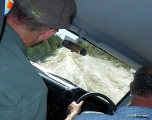 Hugh at the wheel of his car with Paul beside him. The roads were extreme.